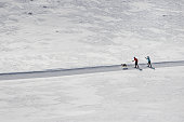 istock Man and Woman Cross Country Skiing 1142068524