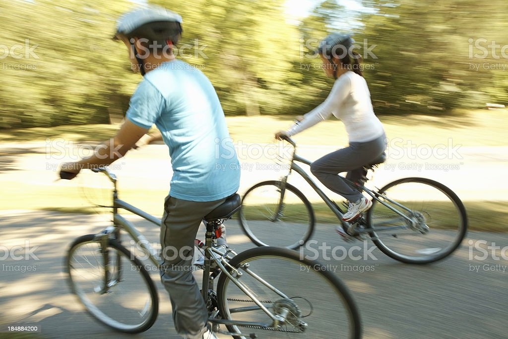 Man and woman cycling together royalty-free stock photo