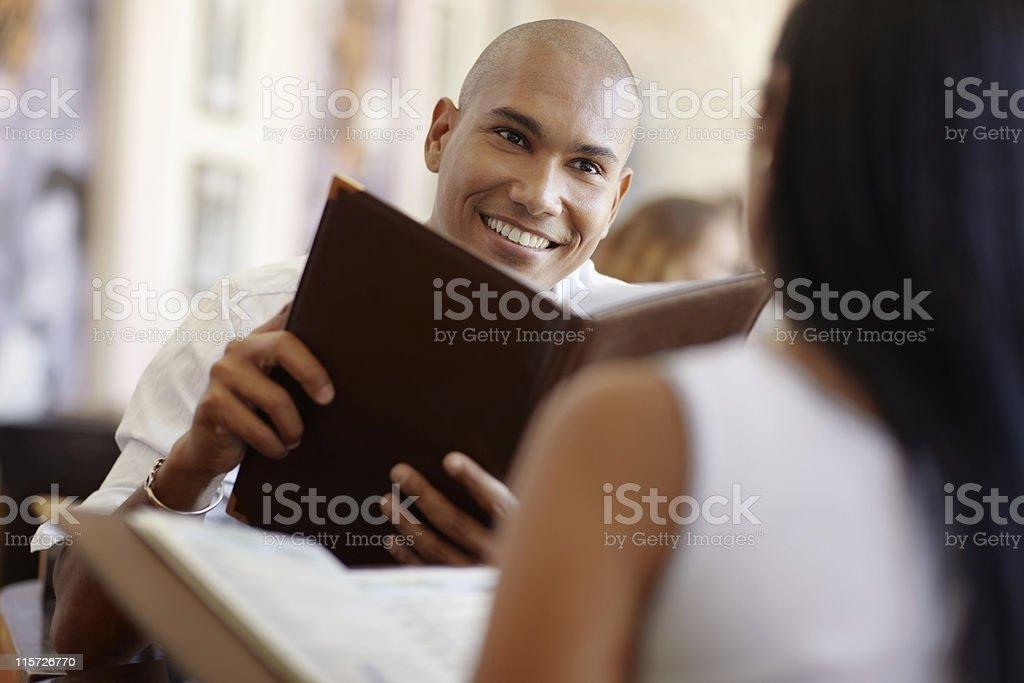 man and woman dating at restaurant royalty-free stock photo