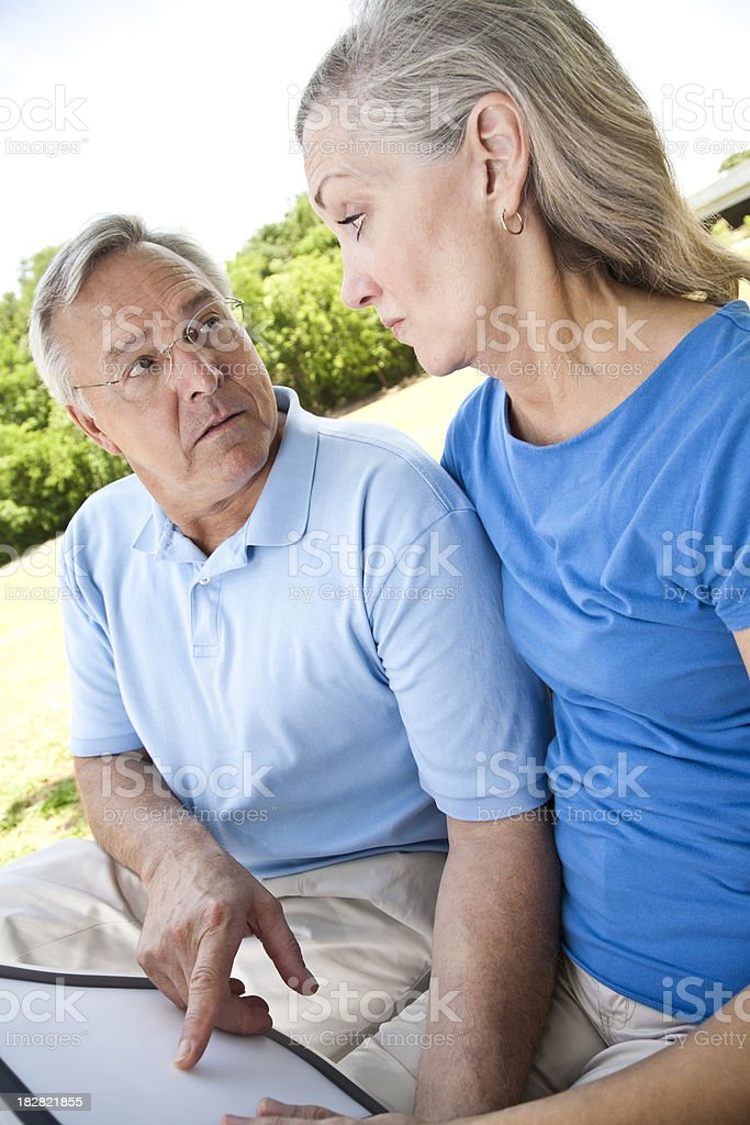 man and woman discuss a document royalty-free stock photo