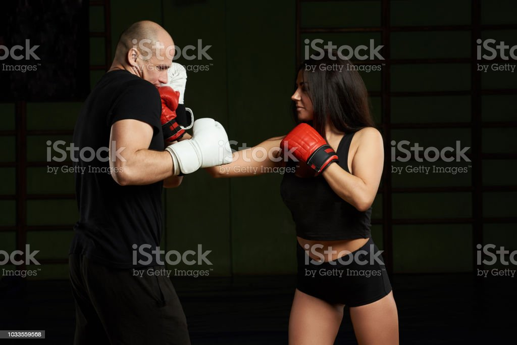 Man and woman doing boxing training stock photo