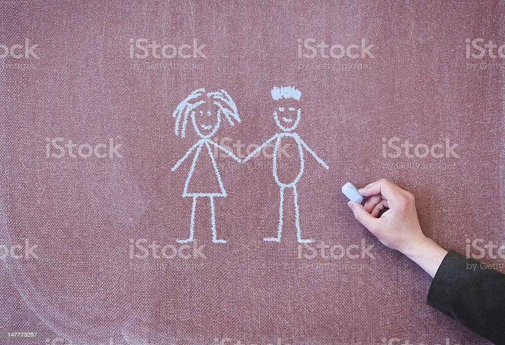 Man and woman drawn in chalk on blackboard royalty-free stock photo