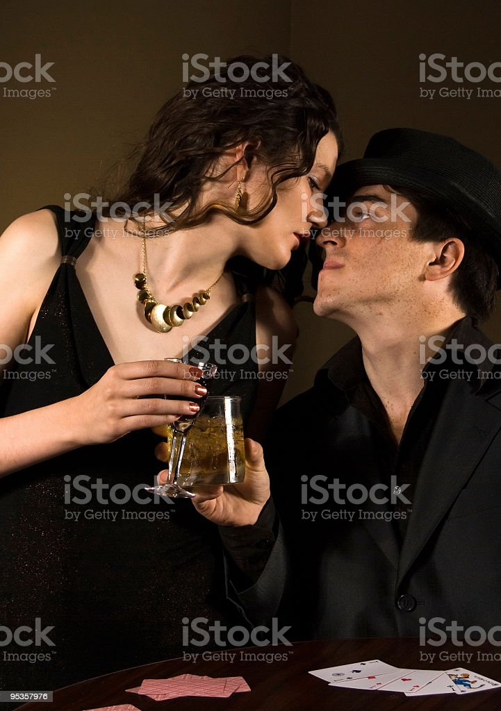 man and woman drink alcohol in retro style royalty-free stock photo