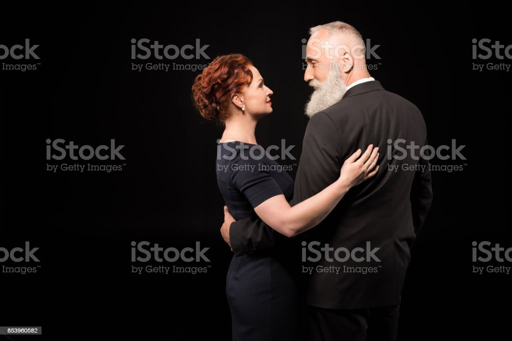 man and woman embracing stock photo