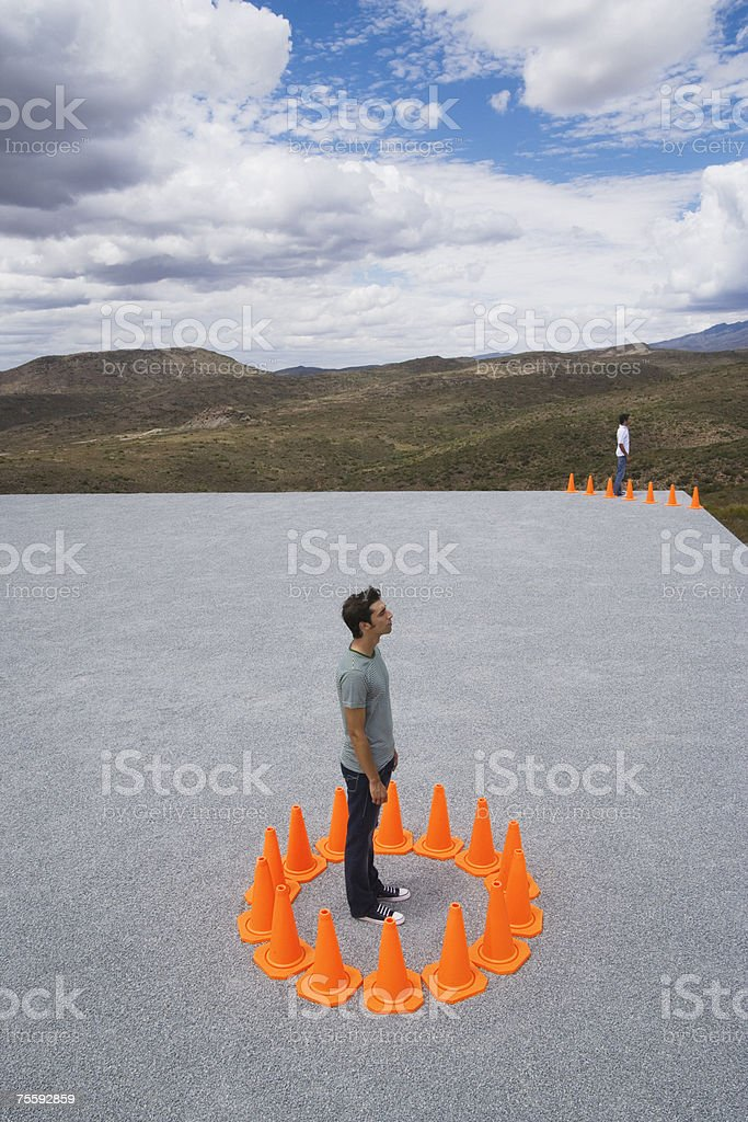 Man and Woman encircled by safety cones royalty-free stock photo