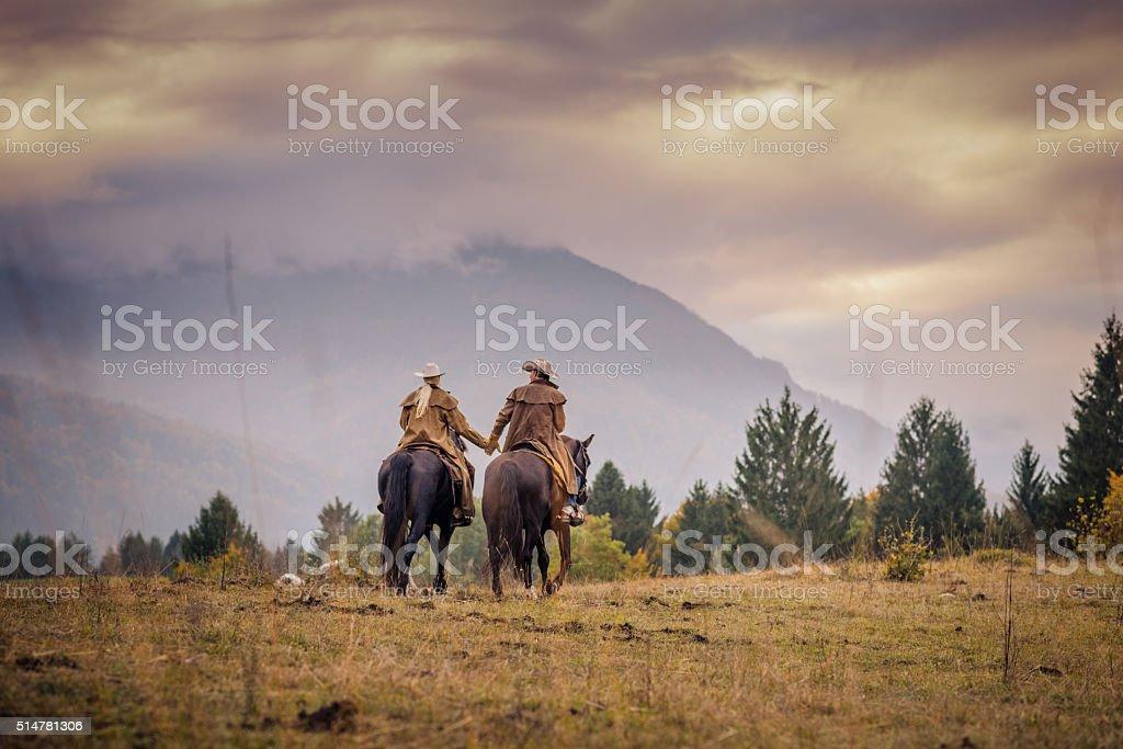 Man and woman enjoying horse riding stock photo