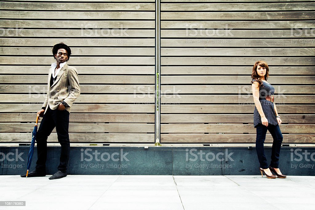 Man and woman facing away from each other stock photo