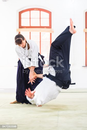 istock Man and woman fighting at Aikido martial arts school 547050598