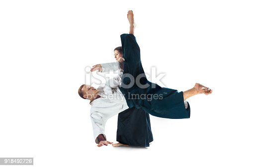 istock Man and woman fighting at Aikido training in martial arts school 918492726