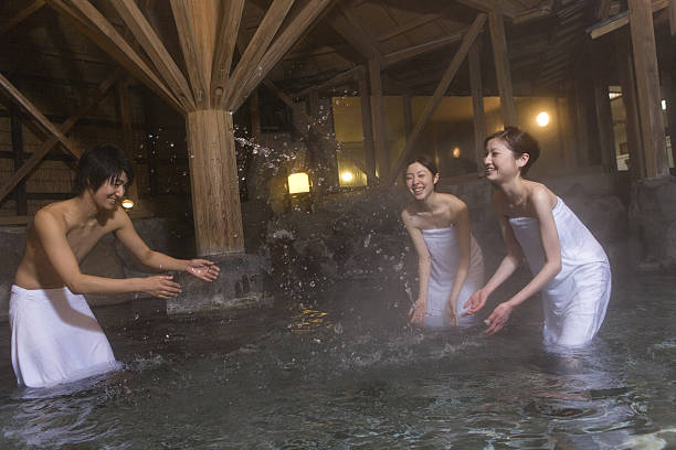Man and woman frolicing in hot spring stock photo