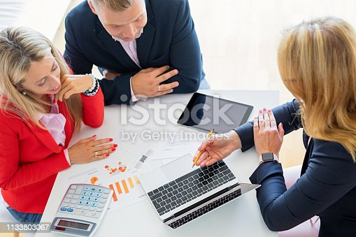 Man and woman getting help from professional financial consultant, view from above