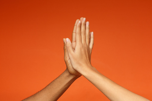 istock Man and woman greeting each other with high five 1127568145