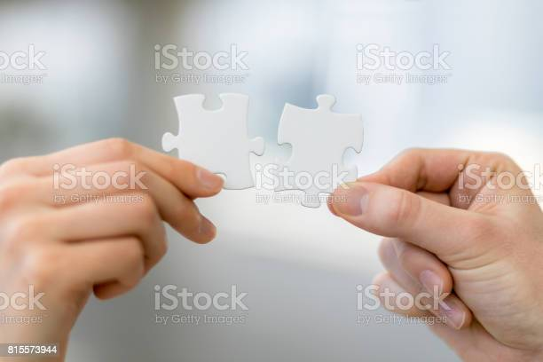 Man and woman hand holding jigsaw puzzles business matching concept picture id815573944?b=1&k=6&m=815573944&s=612x612&h=x2ubd1emmgc9lydndyrv 4avawxjwl9 86xs2hilp2a=