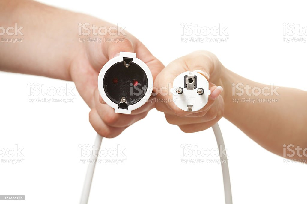 Man and woman hands holding European plug and outlet isolated royalty-free stock photo