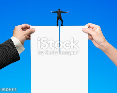 94113879istockphoto Man and woman hands tearing blank paper with businessman standin 512044314