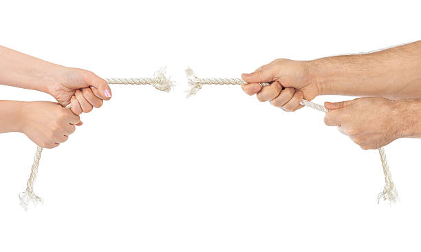 Man and woman hands with breaking rope stock photo