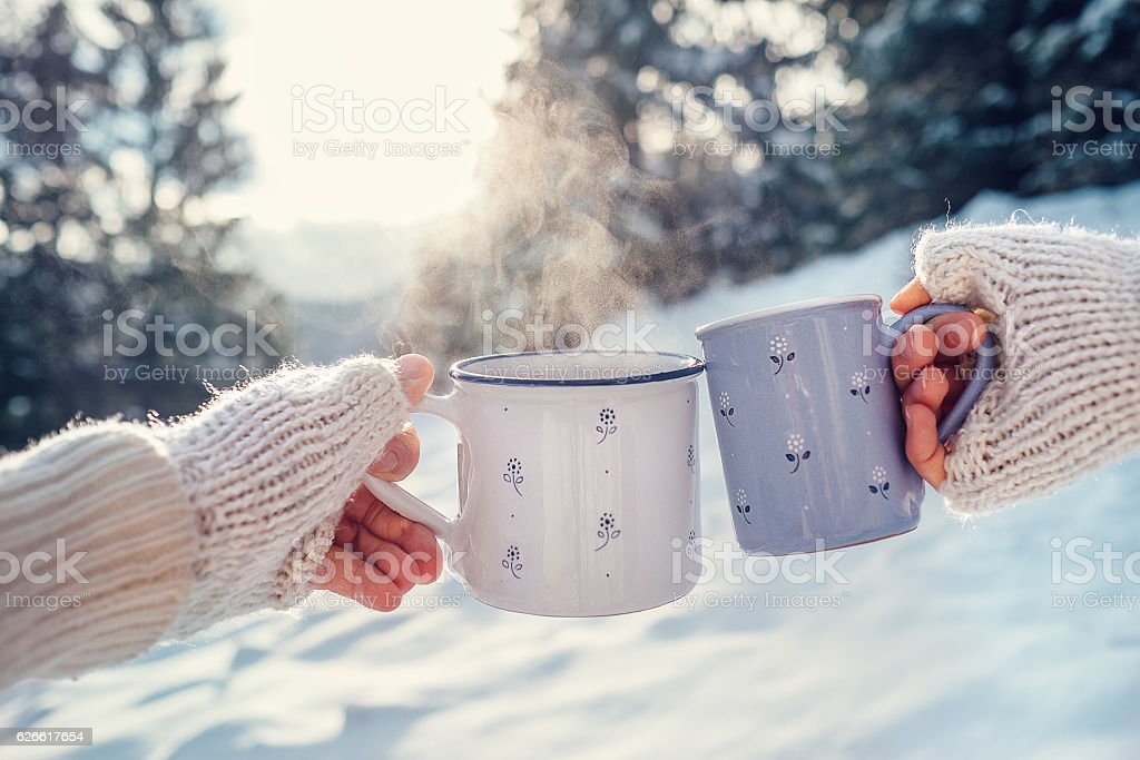 Man and woman hands with cups of hot tea stock photo