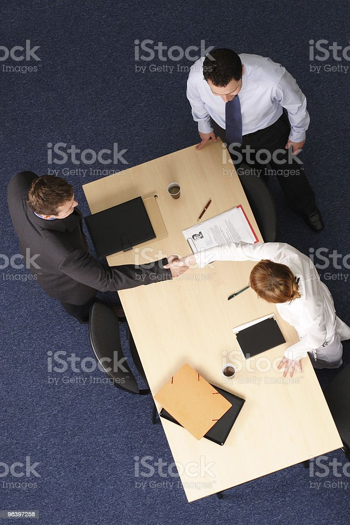 man and woman handshake at the meeting stock photo