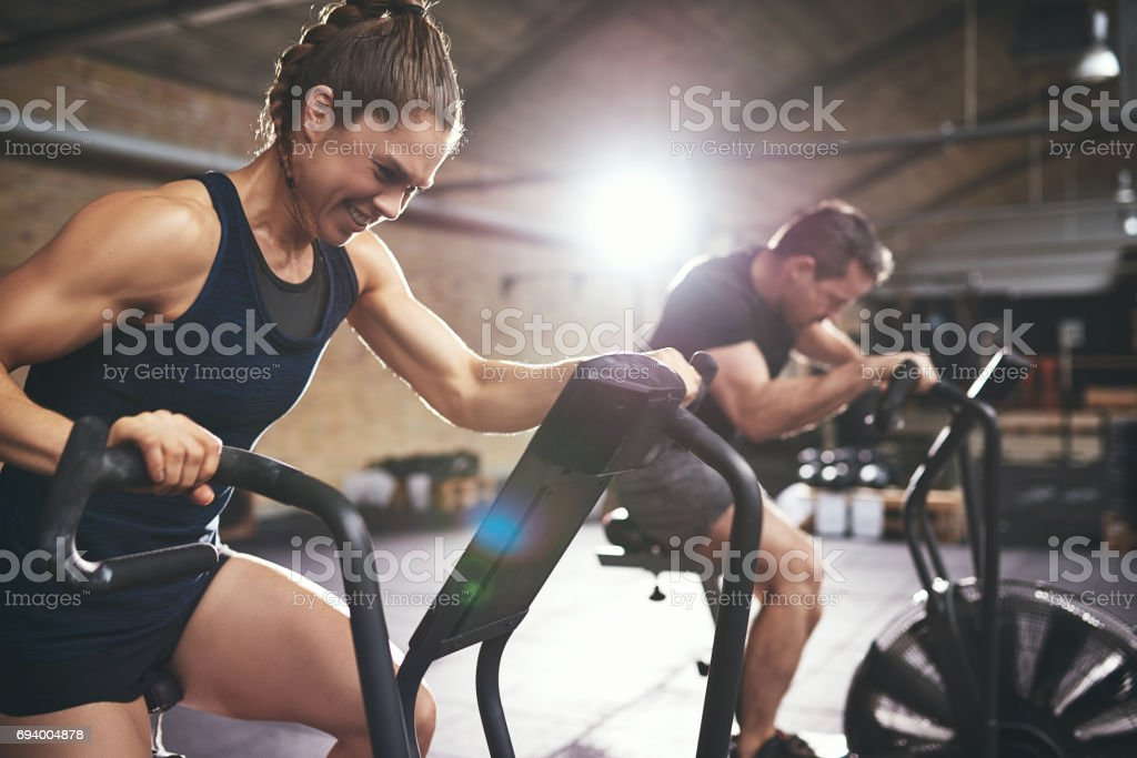 Man and woman hardly exercising at gym stock photo