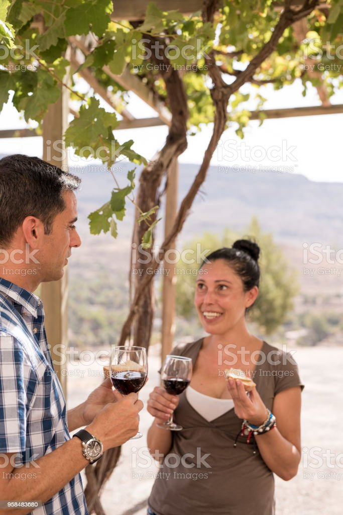 A man and woman having a glass of red wine stock photo