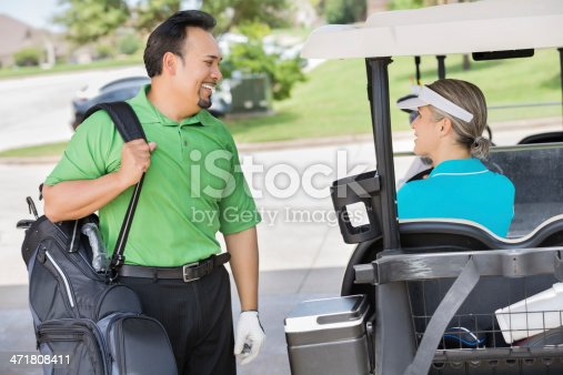 Man and woman having friendly conversation before playing golf