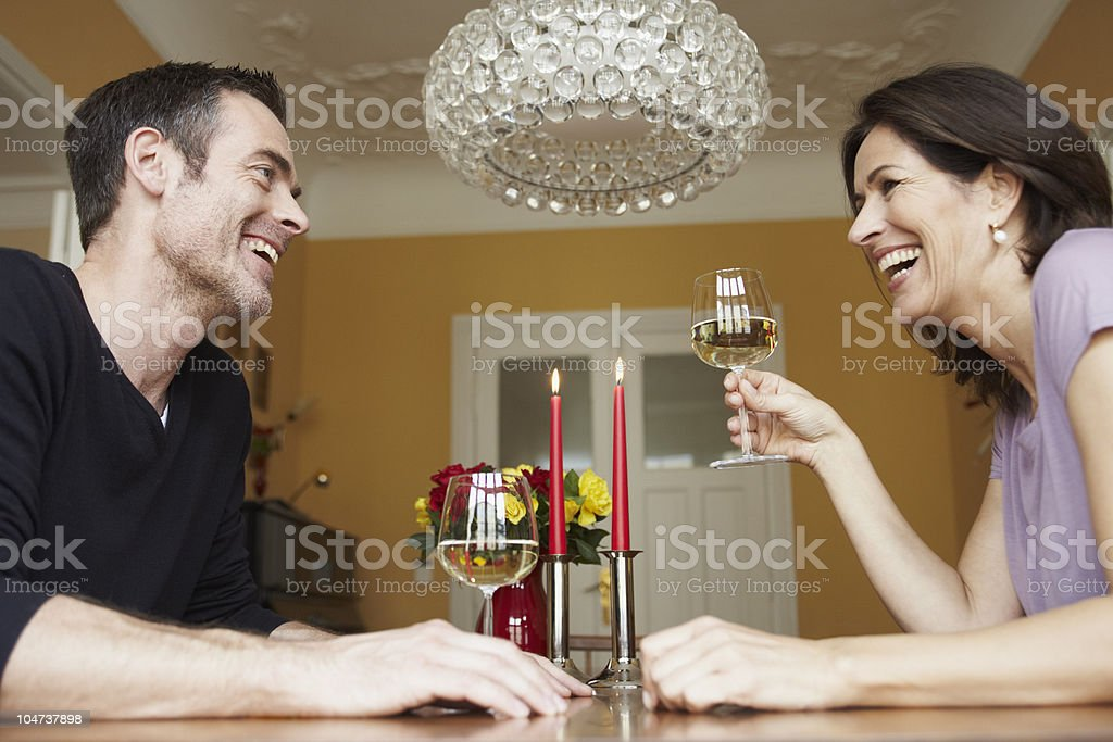 Man and woman having glass of wine royalty-free stock photo