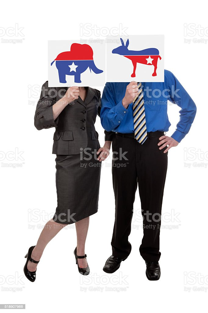 Man And Woman Hiding Behind Political Party Symbols stock photo