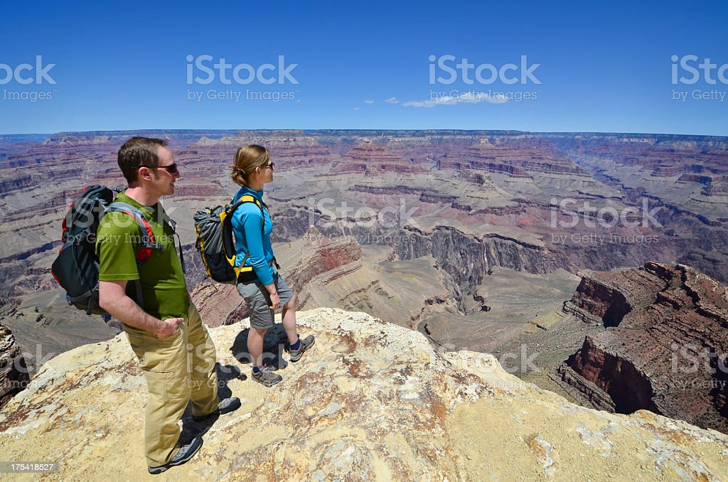 A man and woman hiking in the Grand Canyon stock photo