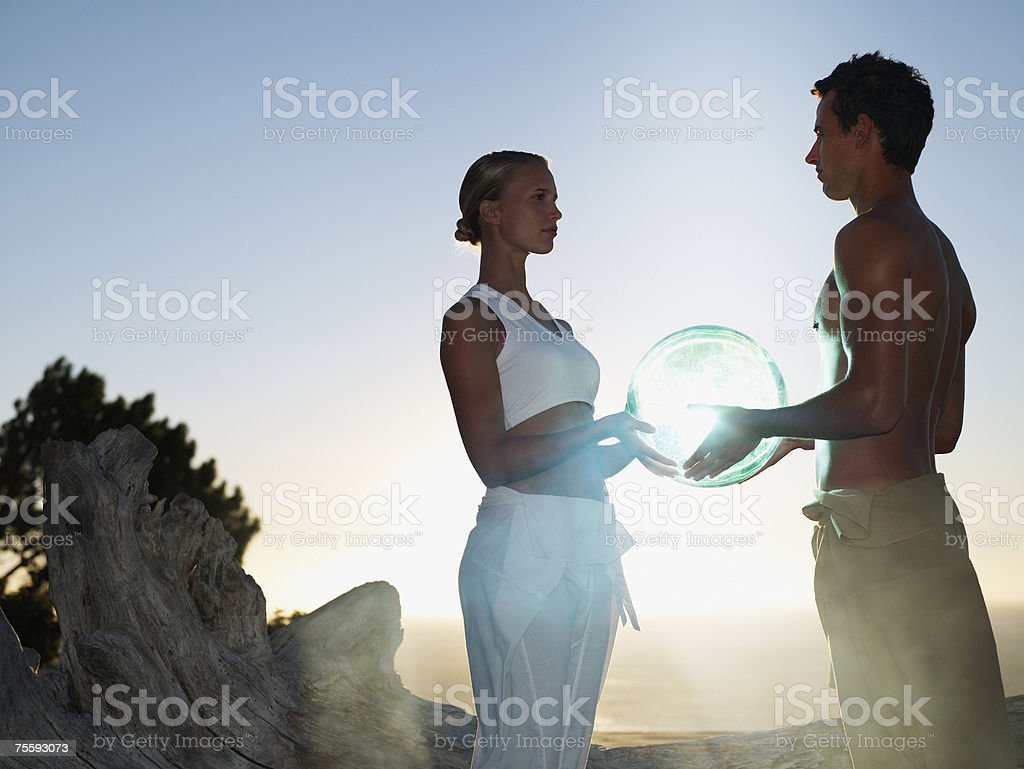 A man and woman holding an orb royalty-free stock photo