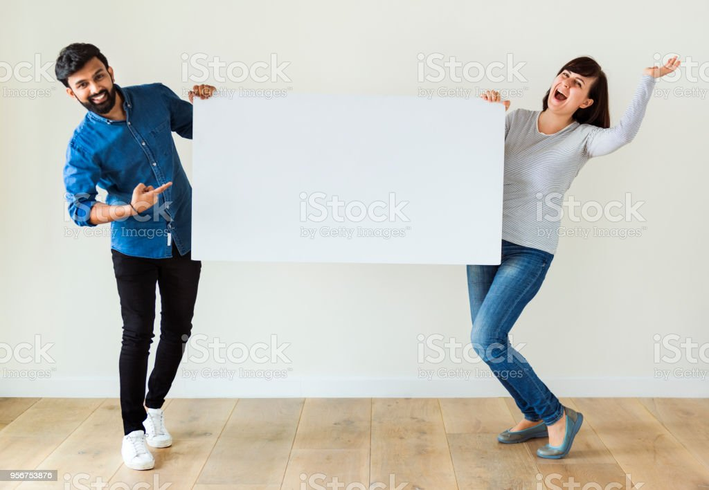 Man and woman holding blank board copyspace stock photo