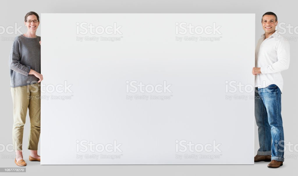 Man and woman holding blank board stock photo