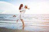 A man and woman hugging each other with joy, happy couple relax on the beach.