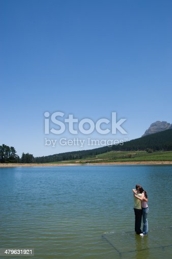 istock Man and woman hugging with standing on water  479631921