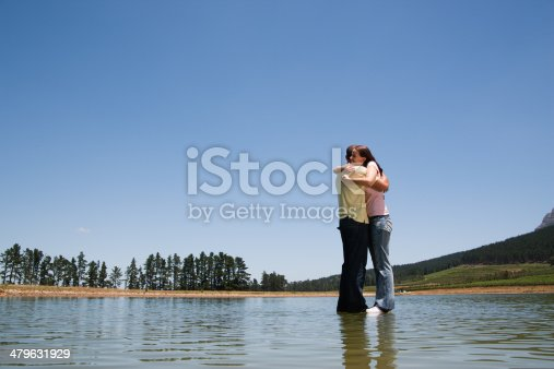 istock Man and woman hugging with standing on water  479631929
