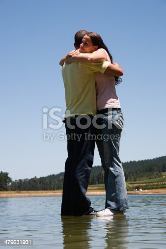 istock Man and woman hugging with standing on water  479631931