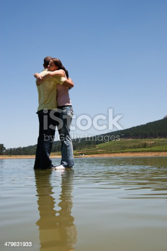 istock Man and woman hugging with standing on water  479631933