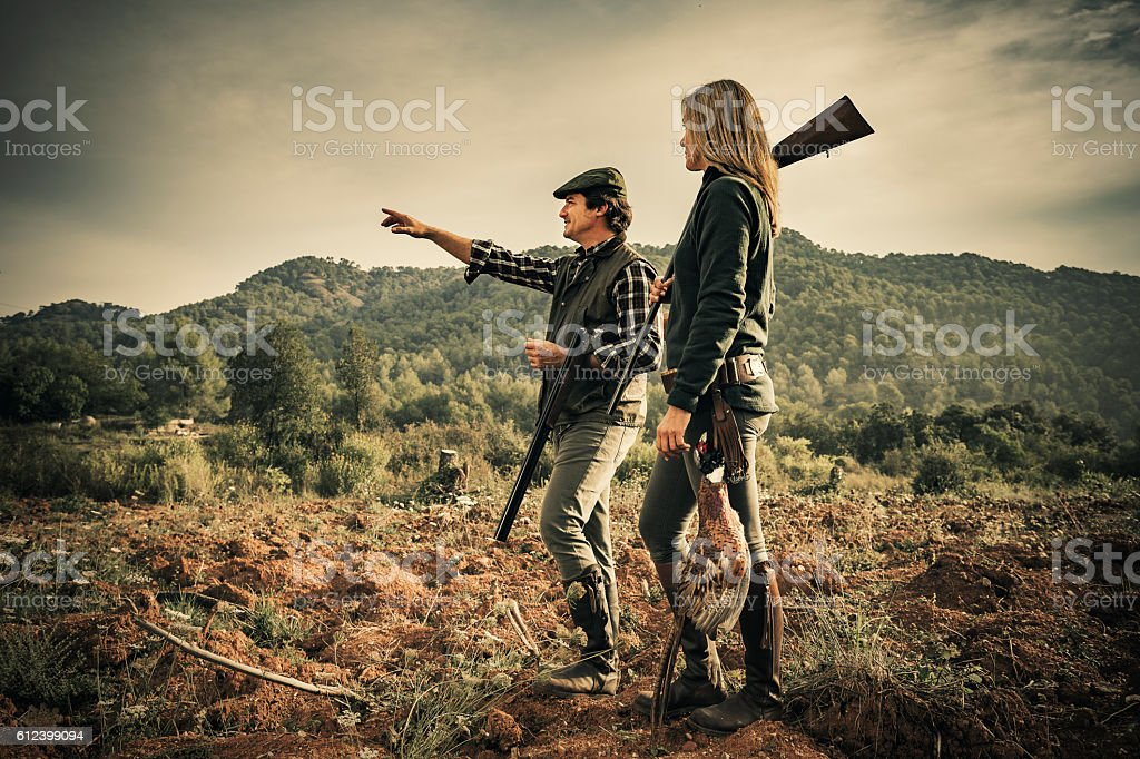 Man and woman hunting pheasants stock photo
