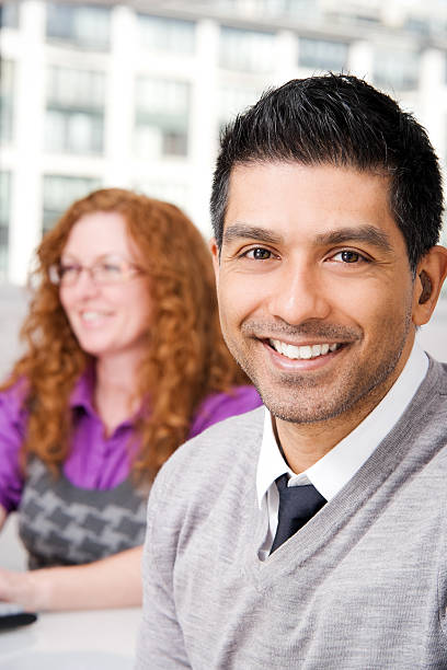 Man and Woman in an Office stock photo
