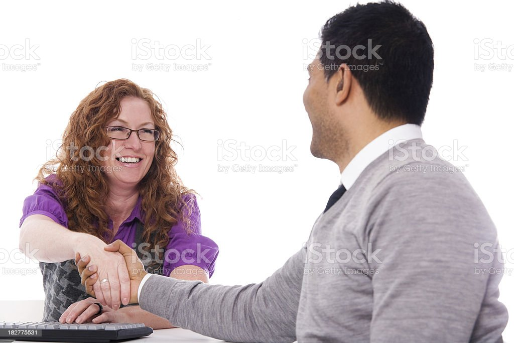 Man and Woman in an Office Shaking Hands royalty-free stock photo