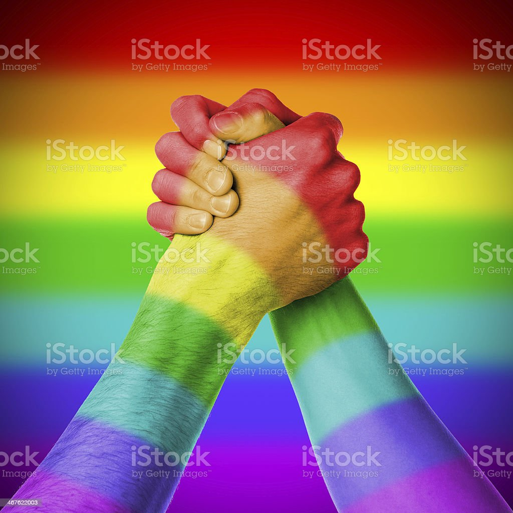Man and woman in arm wrestlin, rainbow flag pattern royalty-free stock photo