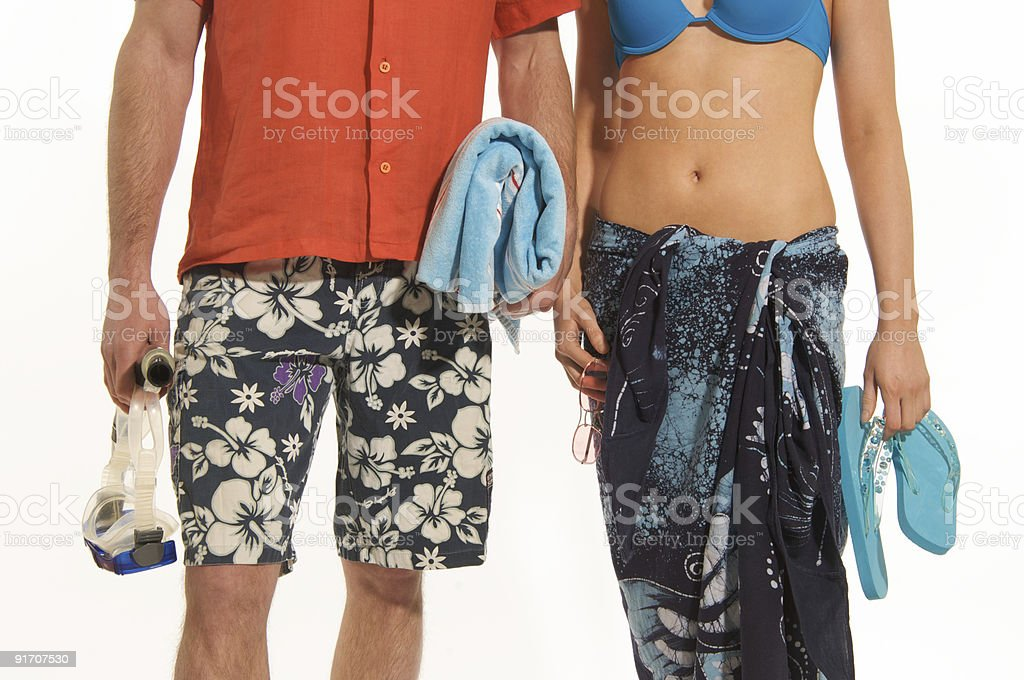 Man and woman in beachwear royalty-free stock photo
