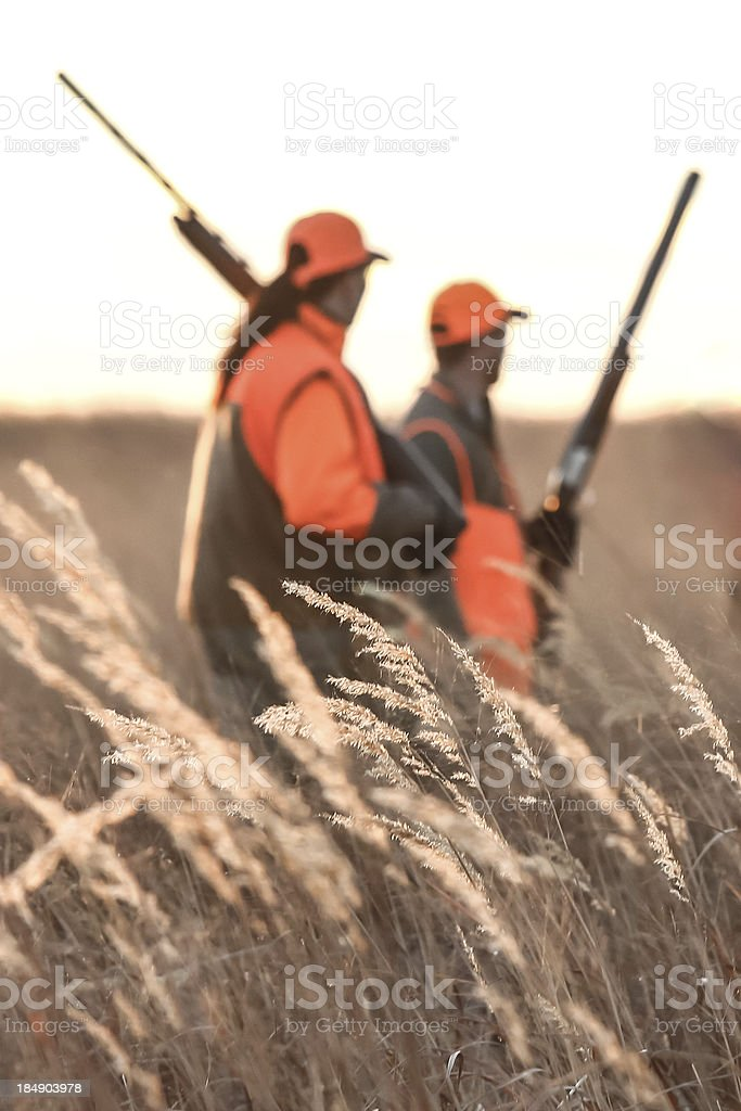 Man and Woman in Field Hunting stock photo