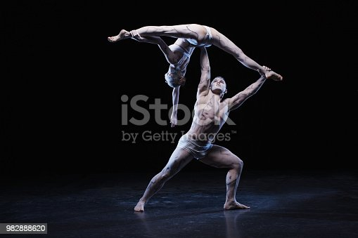 istock Man and woman in passionate dance pose 982888620