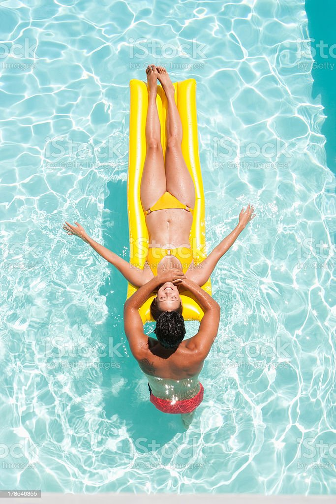 Man and woman in swimming pool stock photo
