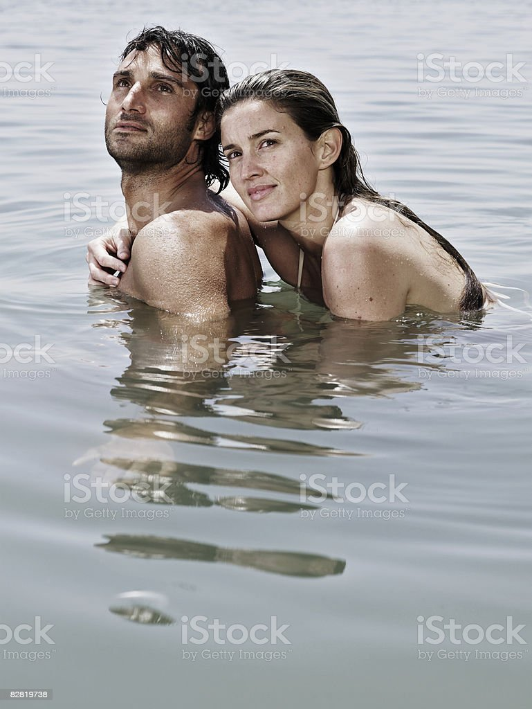 Man and woman in the sea royalty free stockfoto
