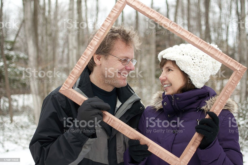 Man and Woman in Winter Forest royalty-free stock photo