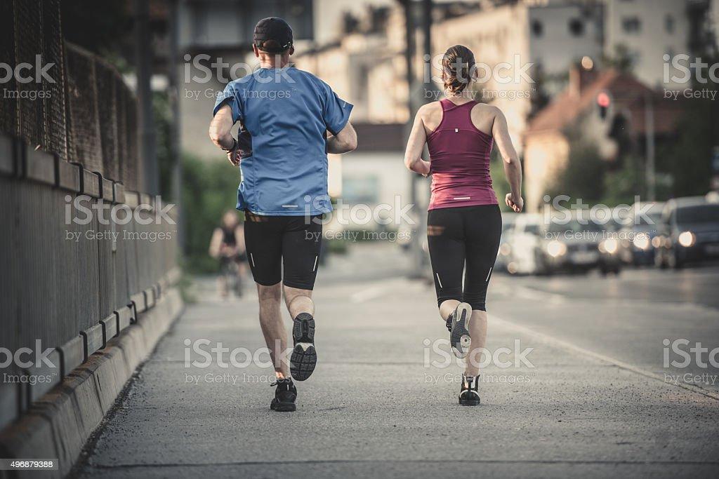Man and woman jogging stock photo
