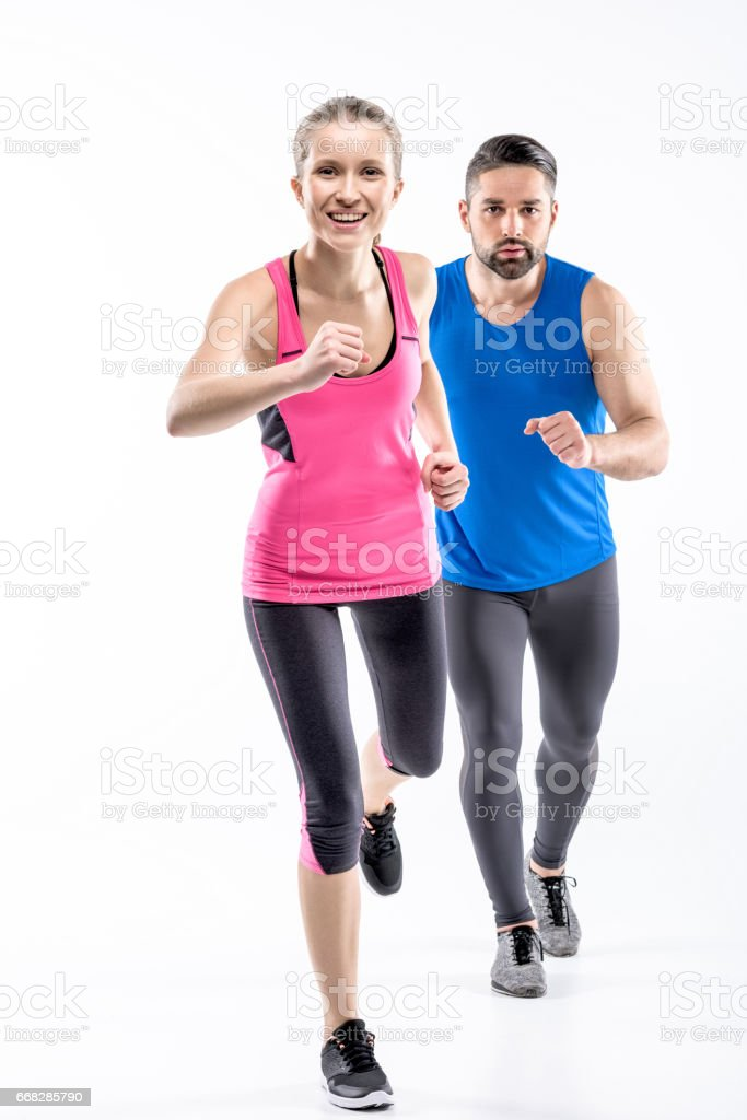 Man and woman jogging stock photo