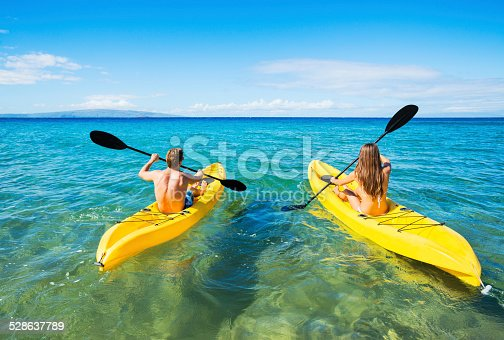 istock Man and Woman Kayaking in the Ocean 528637789