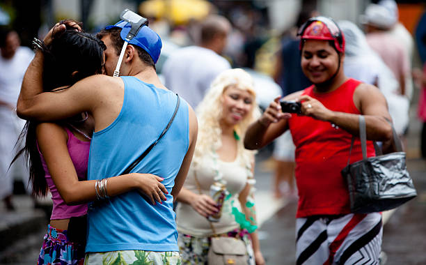 Man and woman kissing during Carnival in Rio stock photo